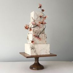 "Modern Masterpieces ~ Jasmine Rae Wedding Cakes ~ bas relief ""stone"" cake with rice paper flowers"