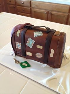 100% edible. Vintage Travel Suitcase Cake. Complete with gum paste key. Red velvet cake, with a fresh raspberry filling. Topped with a vanilla buttercream frosting, and then covered in fondant    Uploaded by Stacy on Sunday Dec 09 11:12:38 2012  Submitted into the December, 2012  Inkedibles Contest