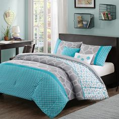 Add a bright touch to your guest room or master suite with this colorful comforter set, showcasing a geometric pattern.   Product: