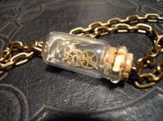 Time Traveler Steampunk Bottle Necklace by TheCuriositeer