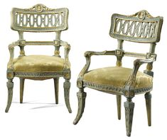 A pair of Italian pale blue painted and parcel-gilt neo-classical armchairs, Lucca, late 18th century.