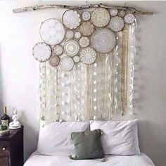 Almost like a curtain, this dream catcher design is made up of many dream catchers with different loop styles attached together. Then a curtain of laces, feathers and beads are attached below.