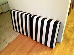 DIY ottomans from $8 ikea tables -- awesome. I was going to toss this shitty little table.