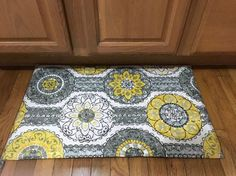 11 Gorgeous Reasons to Try Fabric in Your Kitchen Decor {{it says to just add fabric to a cheap dollar store rug. (***Another site said they used a shower curtain (not regular fabric) to dress up this cheap & plain dollar store rug AND both posts are using the same pic!?***)