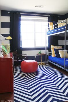 Boy Room Makeover. Love the bold stripes and the pops of yellow and orange/red.