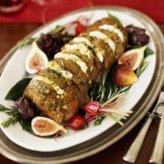 To make this gorgeous rosemary-accented tenderloin, roast the meat, then tuck creamy rounds of cheese between the succulent slices. http://www.bhg.com/christmas/recipes/christmas-dinner-menus/?socsrc=bhgpin122114rosemarybeeftenderloin&page=22