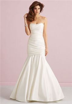 This strapless satin gown features ruching across the fitted bodice, opening to a mermaid style skirt.