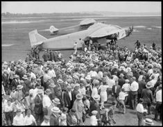 Amelia Earhart arrives at East Boston Airport in Ford Trimotor, 1927