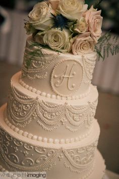 beautiful buttercream wedding cake take off the large flowers maybe like the lacey stuff