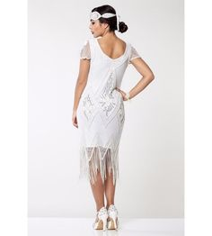 This Flapper Style Fringe Party Dress in White Silver recaptures the glamour of 1920's fashion. The classic scalloped sleeves and soft V-neck preserve the vintage look, while highlighting the modern fit. Flapper Style Dresses, Gold Sequins, Vintage Looks, Soft Fabrics, Vintage Inspired, Party Dress, Tulle, White Dress, Vintage Fashion