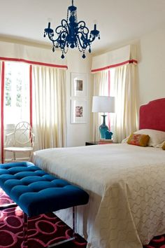royal blue  hot pink  upholstered  velvet   headboard  white  bedding  glossy  blue  chandelier  ivory cornice box  boxes  ivory drapes  pink  ribbon  border  window treatments  blue  velvet  tufting  tufted  bench  pink  geometric  rug  baby blue  gourd  lamp  ivory walls  paint color  bedroom