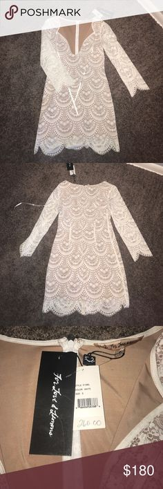 White Lace Dress White lace dress with nude slip/bare lace arms. Perfect for formal, social, date party, etc. NWT Size small fits 0-4 (maybe 6 if smaller chest) For Love and Lemons Dresses Mini