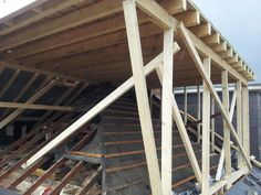 Hip-to-gable loft conversion mid construction. Flat roof dormer window to meet new gable and replace old hip end.