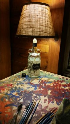 My newest craft! A lamp made with a Krakken rum bottle and a burlap lampshade!