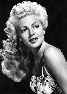 Lana Turner LOVE the hair and makeup kinda looks like Lindsay Lohan pre-crazy