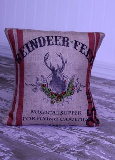 "Pillow made from a ""Reindeer feed"" sack for ""flying caribou"".  This would make anyone smile. :D"