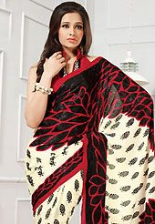 Exquisite combination of color, fabric can be seen here. This cream, black and red georgette saree is nicely designed with floral and abstract print work. Saree gives you a singular and dissimilar look. Matching red blouse is available. Slight color variations are possible due to differing screen and photograph resolution.