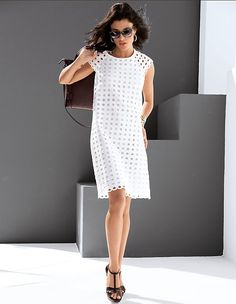 MADELEINE - A feminine and alluringly sensual look. This dress makes a summer statement, achieved through its striking broderie anglaise. Moderately flared A shape with round neckline, small raglan sleeves and seam-fine zip at the back. Full opaque lining in the body.