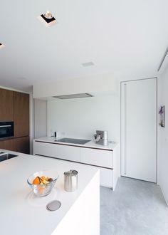 Modern white interior doors - cutstom-made by Anyway Doors with built-in handles and an invisible door frame. #moderndoors #interiordoors