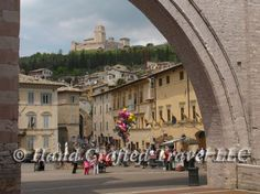 Travel Picture: Day 199. The Rocca Maggiore, a 14th century castle, crowns the hill above Assisi, Italy, the village of Saint Francis. This shot was taken from the square in front of the convent of the Poor Clares.