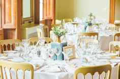 Vintage books & brass table setting (Photo by Helena Dolby Photography)