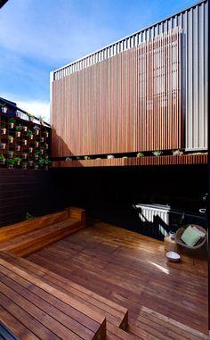 Vertical wooden screen as house facade