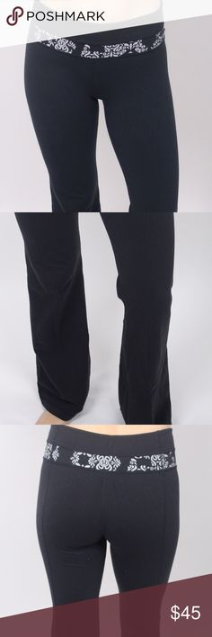 LuLulemon boot cut yoga pants LuLulemon boot cut yoga pants, in black with a floral print waistband. Features a small front pocket on the left side for credit cards, etc. lululemon athletica Pants Track Pants & Joggers