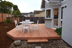 Traditional Deck with Boulders and Large Rocks, Pathway, Brown Pressure Treated Hemlock Fir Deck Board (2x6), Fence
