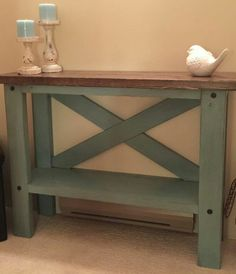 This Farm House Console Table brings a little rustic charm into your home.