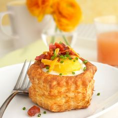 Bacon Egg and Cheese Puff Shells | - frozen Puff Pastry Shells 6 large eggs - 2 tablespoons shredded Cheddar Jack cheese - 6 slices bacon, cooked and crumbled (about 6 tablespoons) - 1 tablespoon chopped fresh chives ... Bake at 400-f for about 20 min