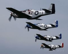 FlightAware ✈ Photo of 4 North American P-51 Mustangs
