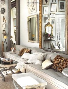 Living room, eclectic, comfy seating, lots of mirrors and collectibles, leopard pillows