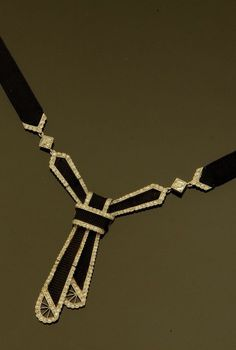 An Art Deco braided silk cord, platinum and diamond necklace. #ArtDeco #necklace