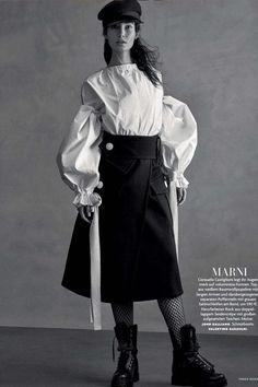 Lily Aldridge wearing Valentino 25mm Rockstud Leather Combat Boots, John Galliano Fall 2016 Hat, Marni Patch Pocket Skirt, Marni Long…