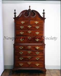 """c.1760-1780, Mahogany and chestnut chest-on-chest with ogee pediment. Four drawers in lower chest, three large and two small drawers in upper chest. Fluted bowl finials on fluted plinths, closed pediment, shaped panels below pediment, stop-fluted quarter columns on both chests, ogee bracket feet with continuous bracket running below the lower case molding. Descended in the Audrey Clarke family of Newport. Closely related examples: RISD, 59.251; and coll. Of Robert Goelet (illus: """"Ott, J. B... Antique Furniture, Painted Furniture, Brown House, Small Drawers, Furniture Styles, Queen Anne, Lowercase A, 18th Century, Household"""