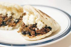 Arepas are popular in Colombia, Venezuela, and other Spanish-speaking countries. The defining factor of an arepa is the flat, corn-dough patty that can be grilled, baked, broiled, or fried. Inside of the arepa you can fill it with a variety of fillings including meat, cheeses, and vegetables.