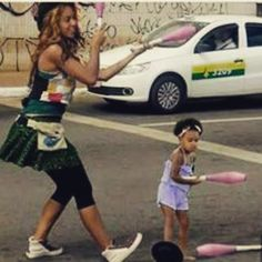 Beyonce & Blue playing with clubs