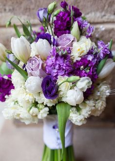 Complete guide to purple wedding flowers purple flower names pics stunning bouquet with purple and white flowers including roses tulips and a whole lot of other beautiful blooms mightylinksfo