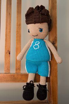 Crochet handmade football boy doll. Amigurumi boy doll.