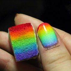 Rainbow nail art. This is so cool. I have to try this, but I know I'll fail since I do at every other nail art project that I've ever tried.