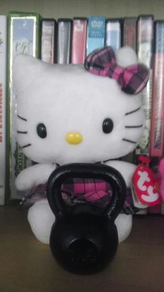 hello kitty posing with our 1lb Baby Kettlebell at http://babykettlebell.com