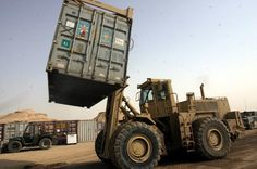 A Rough Terrain Cargo Handler moves an ISO container. Task Force Roadrunner is the only unit here with equipment capable of moving such cargo.