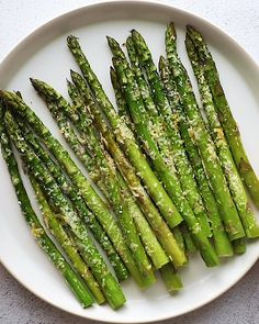 Oven Roasted Asparagus Recipe Oven roasted asparagus with parmesan cheese is the best way to eat asparagus! It's a healthy side dish recipe that's cooked to perfection. Asparagus Recipes Oven, Oven Roasted Asparagus, How To Cook Asparagus, Best Asparagus Recipe, Parmesan Asparagus, Asparagus On The Grill, How To Cook Vegetables, Asparagus With Cheese, Vegetarian Recipes