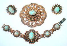 """A set in antiqued copper, embellished with turquoise confetti beads. Japanned backs. Circa 1950s. Unmarked quality. Pin, 2.75"""" diameter; bracelet, 7.25""""L; screw-back earrings, 1.25"""". $59"""