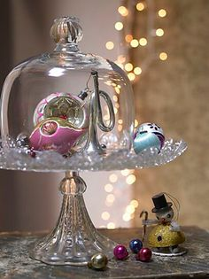 Don't get to use your cake stand much...use it for Christmas with out the cake...how about to display cherished ornaments. Fun and elegant touch for the holidays.
