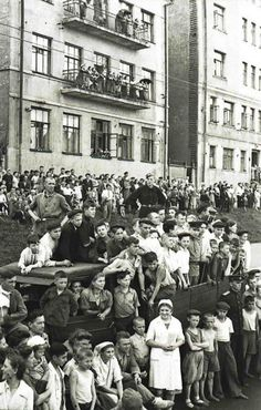 In this candid photo, happy Muscovites watch German prisoners being marched through the streets of the Soviet capital as a demonstration of Red Army victories, July 17, 1944. In all, the parade included some 57,000 German soldiers and officers (including 19 generals), mostly captured in Belarus by the 1st, 2nd and 3rd Belorussian Fronts. Right behind the POW columns came watering tanks, symbolically washing away the Nazis dirt from the Russian asphalt.