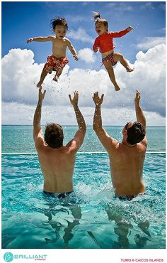 Kids being thrown up in the air. Carefree, fun family portraits. Lifestyle Photography   Andy Mann at Brilliant Studios, Turks and Caicos
