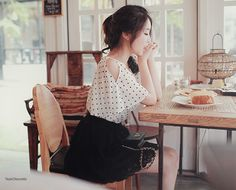 """A cute outfit with spring with the black and white """"cold shoulder"""" blouse with the black skirt."""