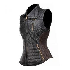 CHAMARRA CUADRA ~ Chaleco de dama en piel genuina de borrego con diseño capitonado de cuello alto, cierre central, bolsillos laterales y elásticos a los costados
