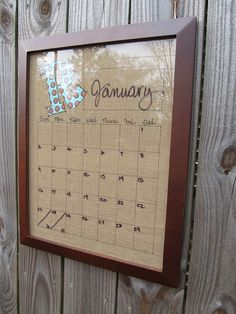 Burlap, Sharpie grid, fused monogram letter, glassed frame, write on with dry-erase pens to change the days and month. So cute!.